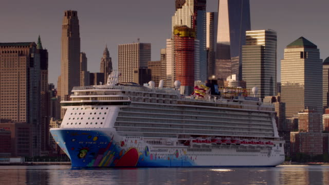 norwegian cruise liner moves along the hudson river in front of lower manhattan skyline. - cruise stock videos & royalty-free footage