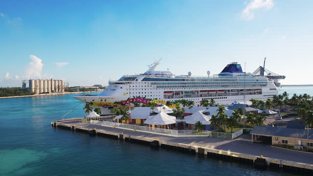 norwegian cruise ship is moored during the daytime in the city bay of water on july 20, 2019; in freeport, bahamas. freeport island which is part of... - traditionally norwegian stock videos & royalty-free footage