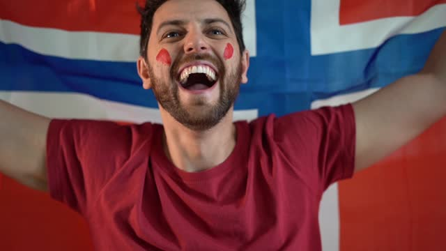 norwegian fan celebrating at home - traditionally norwegian stock videos & royalty-free footage