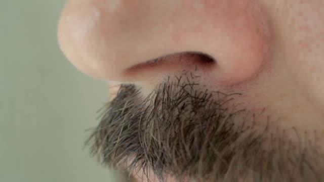 stockvideo's en b-roll-footage met neus van een mens met snor - menselijke neus
