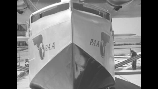 nose of pan american world airways sikorsky s-42 airplane / vs propellers / vs wheels / windows / wing floats / hatch / side view sikorsky s-42 /... - portello video stock e b–roll