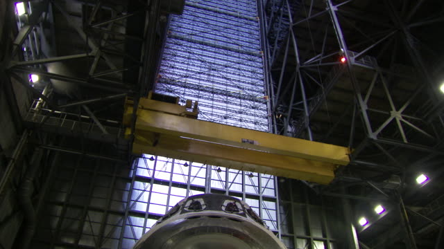 ms td nose of space shuttle discovery inside vehicle assembly building at kennedy space center / cape canaveral, florida, united states - kennedy space center stock-videos und b-roll-filmmaterial