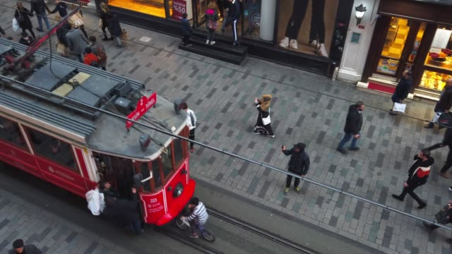 nostalgic red tram in istiklal street from above - non us film location stock videos & royalty-free footage