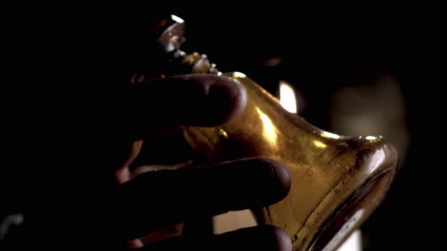 vídeos de stock e filmes b-roll de nostradamus examines the contents of a vial by candlelight. - rasto de movimento