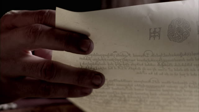 nostradamus grips a piece of parchment. - letter document stock videos and b-roll footage