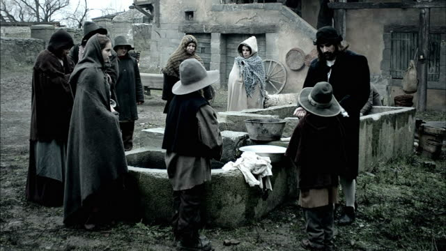nostradamus instructs a young boy in washing his hands at a basin near a well. - historische kleidung traditionelle kleidung stock-videos und b-roll-filmmaterial