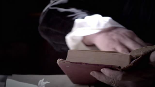 nostradamus reads a book at his desk. - historische kleidung traditionelle kleidung stock-videos und b-roll-filmmaterial