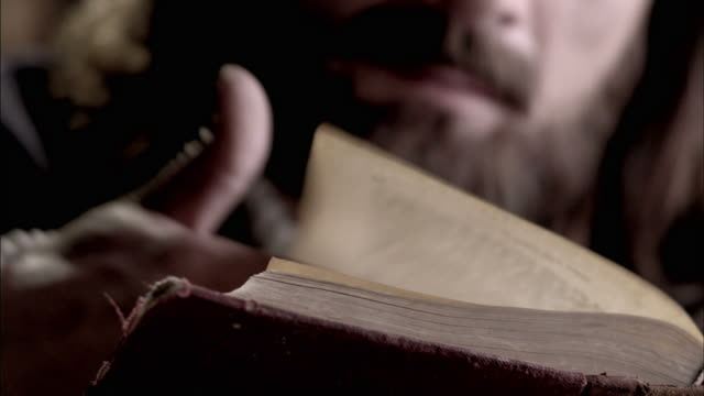 nostradamus thumbs through and reads a book. - history stock videos & royalty-free footage