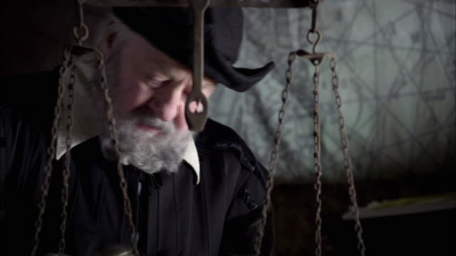 nostradamus uses a mortar and pestle. - mortar and pestle stock videos and b-roll footage