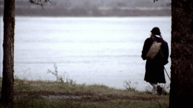 nostradamus walks along a lake shore. - historische kleidung traditionelle kleidung stock-videos und b-roll-filmmaterial