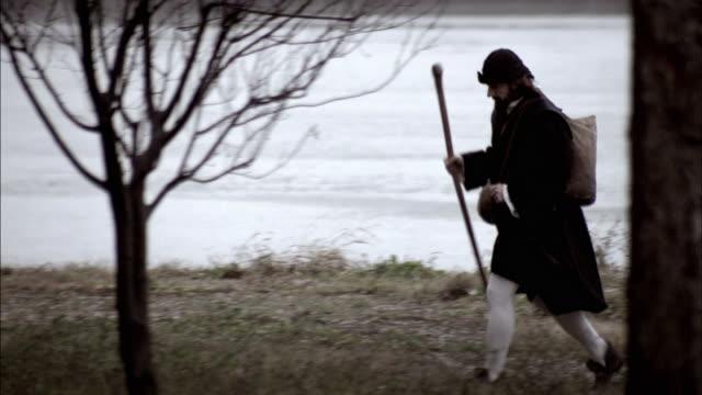 nostradamus walks by a lake. - solo uomini maturi video stock e b–roll