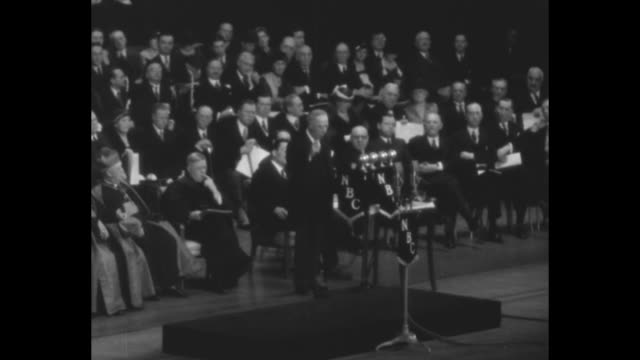 vídeos y material grabado en eventos de stock de ws notables sitting on stage in hall in front of radio city music hall chorus during a religious service marking the beginning of the holy year / sot... - radio city music hall