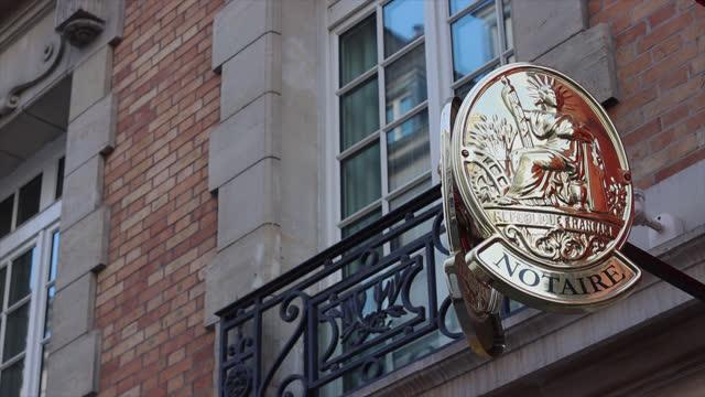 vídeos y material grabado en eventos de stock de notary's plate in france - letrero de tienda
