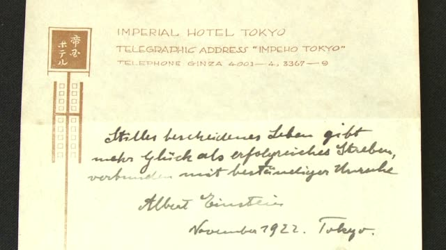 A note that Albert Einstein gave to a courier in Tokyo briefly describing his theory on happy living sold at auction in Jerusalem on Tuesday for $156...