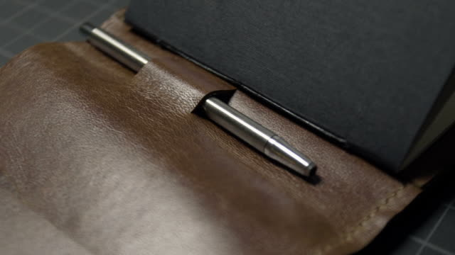 notebook and pen wallet - leather stock videos and b-roll footage