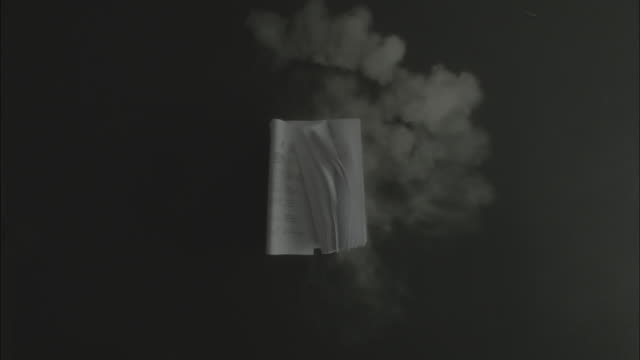 Notebook falls down from the air and drops with dust