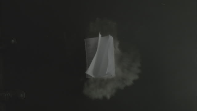 vídeos y material grabado en eventos de stock de notebook falls down from the air and drops with dust - libro