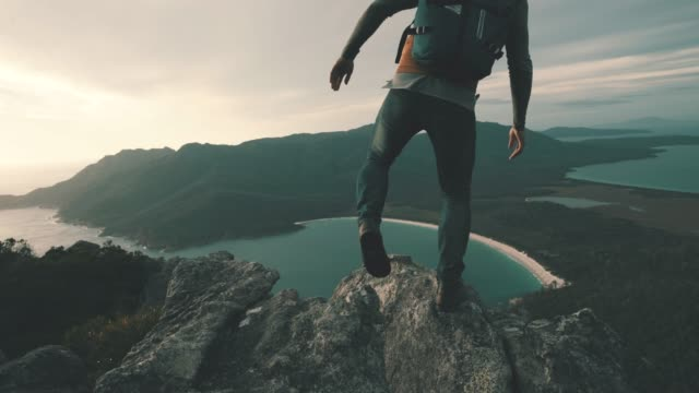 nothing beats climbing a mountain to see the sunrise - hiking stock videos & royalty-free footage