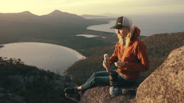 nothing beats climbing a mountain to see the sunrise - camping stock videos & royalty-free footage