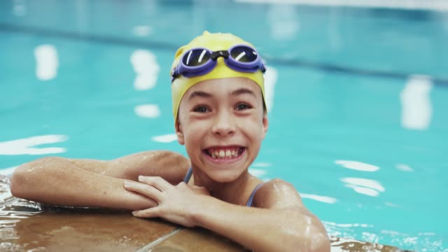 nothing builds confidence in a child like learning to swim - girl swimming costume stock videos & royalty-free footage