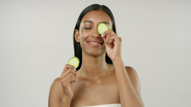 nothing cools down tired eyes like cucumbers - skin care stock videos & royalty-free footage