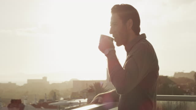 nothing goes better than a good view and coffee - balcony stock videos & royalty-free footage