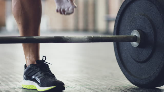 nothing is too heavy - weight training stock videos & royalty-free footage