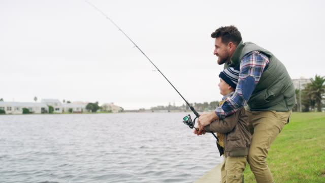 nothing says father son bonding time like a fishing trip - fishing stock videos & royalty-free footage