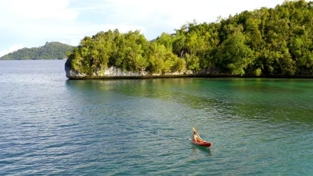 nothing says fun like kayaking under the sun - polynesia stock videos & royalty-free footage