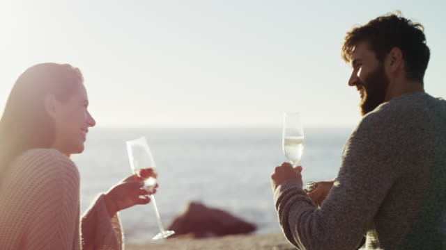 nothing says romance like champagne at sundown - face to face stock videos & royalty-free footage