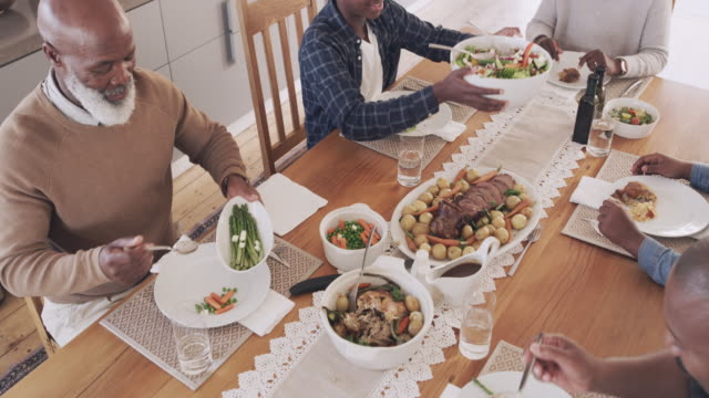 nothing tastes better than a home cooked meal - dining table stock videos & royalty-free footage