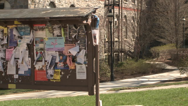 ms notice board on university campus, bethlehem, pennsylvania, usa - poster stock-videos und b-roll-filmmaterial