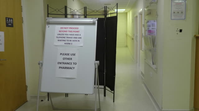 a notice in a gp's surgery advising people not to proceed further due to coronavirus outbreak - warning sign stock videos & royalty-free footage