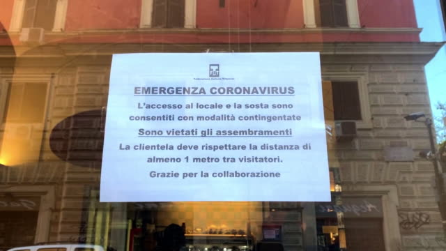 """notices and headlines about coronavirus in bologna - """"bbc news"""" video stock e b–roll"""