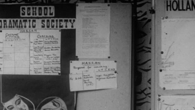 1962 pan notices displaying extracurricular activities at holland park school / kensington, london, england - notice board stock videos and b-roll footage