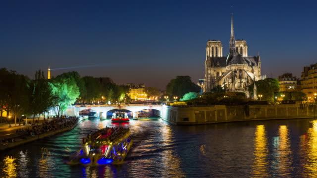 notre dame cathedral and the river seine, paris, france, europe - time lapse - notre dame de paris stock videos & royalty-free footage