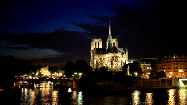 hd: notre dame cathedral at dusk in paris, france - notre dame de paris stock videos and b-roll footage
