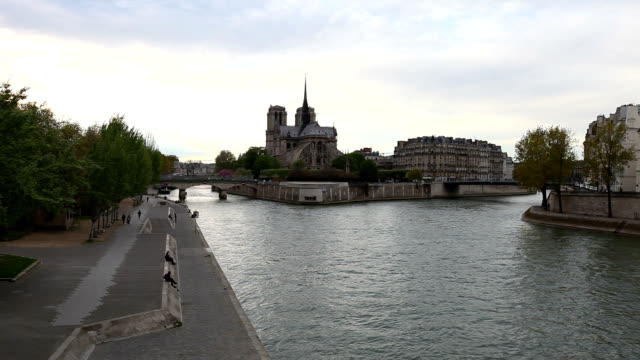 hd: notre dame cathedral at dusk in paris, france - river seine stock videos & royalty-free footage