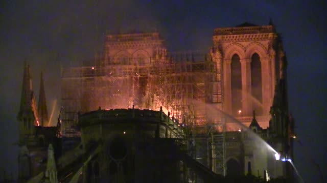 notre dame cathedral burning in paris different angles part 1 on april 15, 2019 in paris, france. a fire broke out on monday afternoon and quickly... - notre dame de paris stock videos & royalty-free footage
