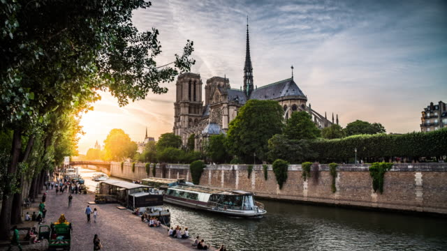notre dame de paris and seine river at sunset, france - seine river stock videos and b-roll footage