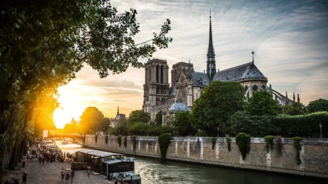 time lapse: notre dame de paris at sunset - paris seine stock videos and b-roll footage