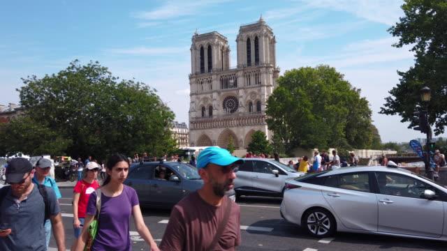 ws notre dame de paris cathedral exterior across street, paris, france - circa 12th century stock videos & royalty-free footage