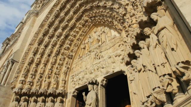 cu  notre dame de paris cathedral  /  paris city, paris, france - female likeness stock videos & royalty-free footage