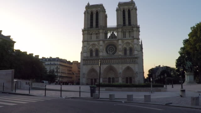 notre dame de paris. driving pov. slow-motion. - moving process plate stock videos and b-roll footage