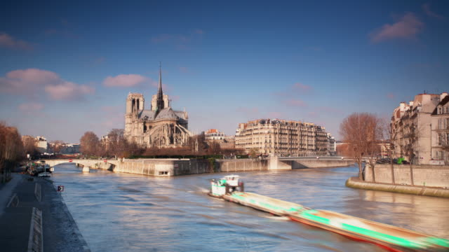 time lapse: notre dame de paris - film montage stock videos & royalty-free footage