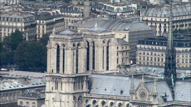 notre dame in sun  - aerial view - île-de-france, paris, france - notre dame de paris stock videos and b-roll footage