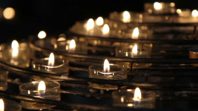 notre dame votive candles - catholicism stock videos & royalty-free footage