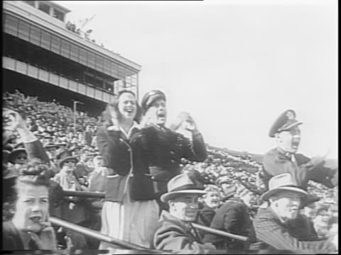 notre dame vs tulane / highlights include crowd shots fans cheering achille f maggioli scoring a touchdown for notre dame in the third quarter /... - anno 1944 video stock e b–roll