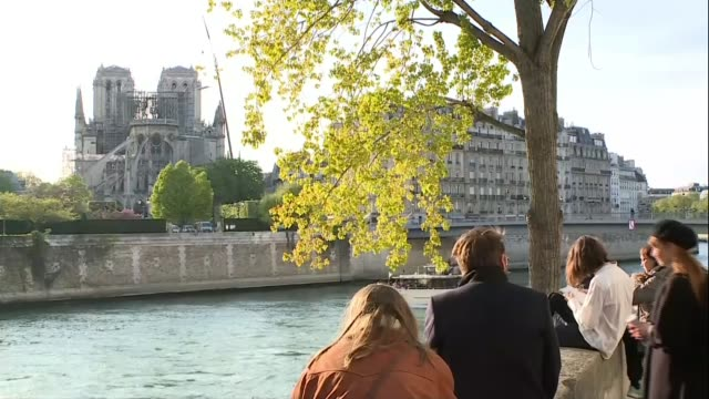 800m Euros pledged to rebuild NotreDame FRANCE Paris Various shots Notre Dame Cathedral seen from across river