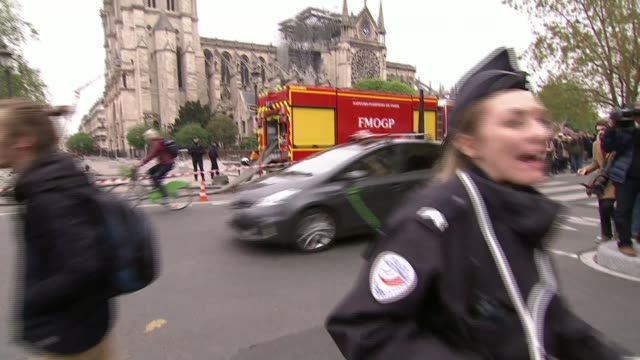 notre-dame cathedral fire: cultural significance; france, paris; various shots of people in street looking at and taking photographs of fire-damaged... - notre dame de paris stock videos & royalty-free footage